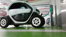 Renault Twizy Electric Car in Charge in an Underground Parking. Cagnes-sur-Mer, France - September 14, 2017: Mini Electric French City Car in Charge in an stock video