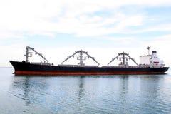 Cago ship. The profile of a Panamax 5-hold cargo ship Stock Photography