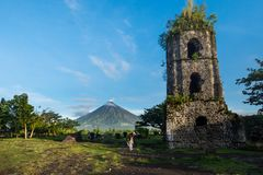 Cagsawa ruins and Mayon Vocalno in Legazpi, Philippines. Mayon Volcano or Mount Mayon, is an active stratovolcano in the province of Albay in Bicol Region, on Stock Image