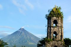 Cagsawa ruins and Mayon Vocalno in Legazpi, Philippines. Mayon Volcano or Mount Mayon, is an active stratovolcano in the province of Albay in Bicol Region, on Stock Photo
