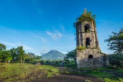 Cagsawa ruins and Mayon Vocalno in Legazpi, Philippines. Mayon Volcano or Mount Mayon, is an active stratovolcano in the province of Albay in Bicol Region, on Royalty Free Stock Photography