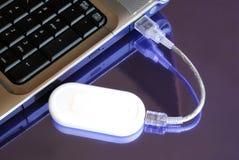 Cahier avec la clé d'Usb 3G de modem Photos libres de droits