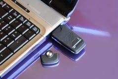 Cahier avec la clé d'Usb 3G de modem Image libre de droits