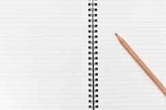 Cahier avec le crayon Photo libre de droits