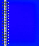 Cahier bleu Photos stock