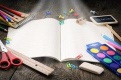 Cahier d'école avec la lumière magique Photo libre de droits