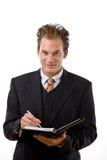 cahier d'homme d'affaires à l'écriture Photos stock