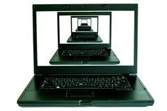 Cahier d'ordinateur sur le blanc photographie stock