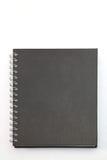 Cahier dur noir de cache Photographie stock