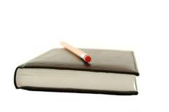 Cahier et crayon Photographie stock libre de droits