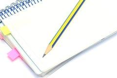 Cahier et crayon Images libres de droits