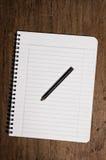 Cahier et crayon Photos libres de droits