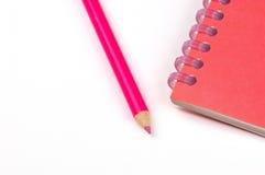 Cahier et crayon Photographie stock