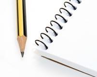 Cahier et crayon Photos stock
