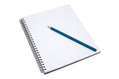 Cahier et crayon blanc Photo libre de droits
