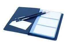 Cahier et crayon (chemin de découpage)   Photo stock