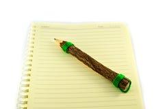 Cahier et crayon de papier photographie stock