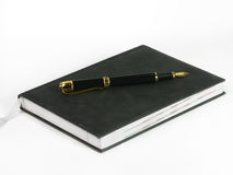 Cahier et crayon lecteur Images stock