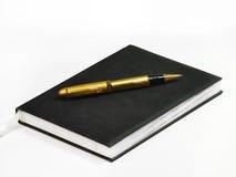 Cahier et crayon lecteur Photographie stock libre de droits