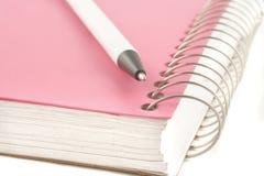 Cahier et crayon lecteur de boucle Photos stock