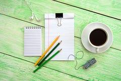 Cahier et cuvette de café Images libres de droits
