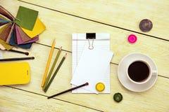 Cahier et cuvette de café Photo stock