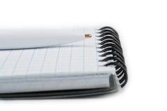Cahier et plan rapproché de crayon lecteur Photographie stock libre de droits