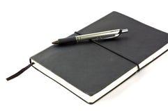Cahier noir Photographie stock