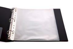 Cahier ouvert avec les poches en plastique Images stock