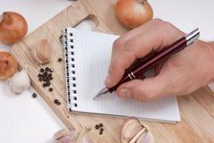 Cahier pour des recettes culinaires Photos stock