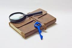 Cahier révélateur et CLÉ Photographie stock