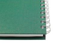 Cahier vert d'isolement sur le fond blanc Photos libres de droits