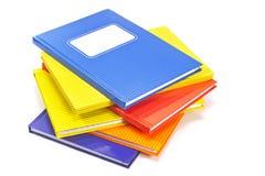 Cahiers colorés d'isolement sur le fond blanc Photo stock