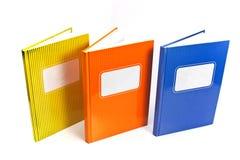 Cahiers colorés d'isolement sur le fond blanc Photos stock