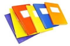 Cahiers colorés d'isolement sur le fond blanc Image stock