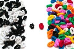 Cahiers noirs et blancs et de couleur de cheveu Photo libre de droits