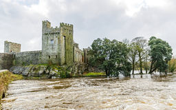 Cahir castle on the flooded Suir riverside Royalty Free Stock Photo