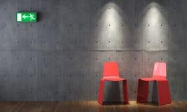 Cahirs rossi moderni di disegno interno sul muro di cemento Immagini Stock Libere da Diritti