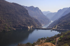 Cahora Bassa Dam. The Cahora Bassa Dam is a dam in Mozambique. It is one of the three major dams on the Zambezi river system Stock Photography