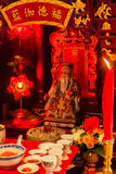 Cai Shen, Chinese God of wealth, God of fortune. Red candle and colorful statue of Cai Shen, Chinese God of wealth, God of fortune, which is a symbol for Royalty Free Stock Photos