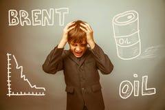 Caiga en el precio del hombre de negocios de la marca del barril de aceite Imagen de archivo libre de regalías