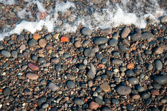 Cailloux à la plage Photos stock
