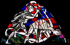 Cain killing Abel in stained glass Royalty Free Stock Image