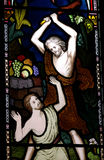 Cain killing Abel. Stained glass window with Cain killing Abel Royalty Free Stock Photography