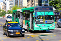Caio. SANTIAGO, CHILE - NOVEMBER 13, 2015: Green city bus Caio in the city street Stock Photo