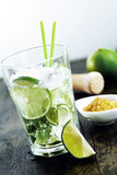 Caipirinha. Drink with brown sugar and a mortar on wooden background. Many other cocktails in my portofolio Stock Photo