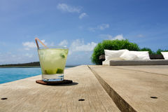 Caipirinha brazilian drink. Brazilian drink in the swiming pool border Stock Photo