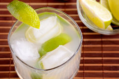Caipirinha Cocktail. With limes, white rum, sugar and ice Royalty Free Stock Photo