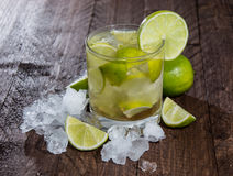 Caipirinha with Crushed Ice on wood Royalty Free Stock Photos
