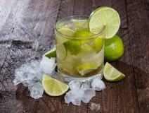 Caipirinha with Crushed Ice on wood Royalty Free Stock Photos
